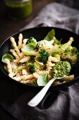 Vegan pasta with broccoli, walnut pesto and basil