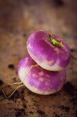 Two purple radishes