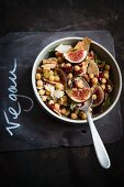 Vegan cheese salad with chickpeas, figs and pomegranate seeds