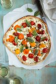 Sheep's cheese pizza with colourful tomatoes