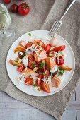 Warm smoked salmon with tomatoes and horseradish