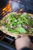 Superfood pizza with red-veined dock, peas, asparagus, and pesto