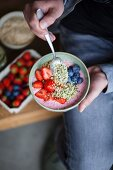 A superfood bowl with strawberries, blueberries, hemp and acai