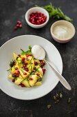 Pineapple salad with pomegranate seeds and soya yoghurt (vegan)