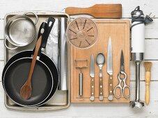 Kitchen utensils for preparing oven-baked asparagus with sauce and pork fillet
