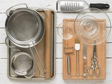 Kitchen utensils for preparing green asparagus wrapped in crispy pastry