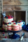Mini naked cakes with fresh berries on a cake stand