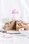 Rhubarb cake with almonds, sliced