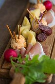 A supper board with cheese, obatzda (Bavarian cheese spread), radishes and ham at Oktober Fest