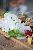 A supper board with cheese, obatzda (Bavarian cheese spread) and radishes at Oktober Fest