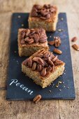 Three slices of pecan nut tray bake cake