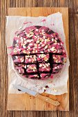 Beetroot brownies with beetroot icing and flaked almonds