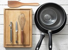 Kitchen utensils for preparing asparagus with scrambled egg