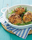 Hasselback potatoes with onion sauce and rocket
