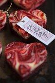 Marbled heart-shaped mini cheesecakes with a gift tag for Valentine's Day