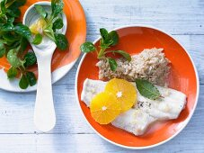 Fillets of plaice in orange sauce with rice and lamb's lettuce