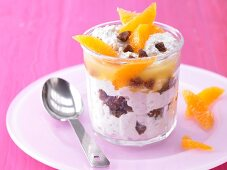 Fresh grain and fig muesli with soured milk and orange fillets