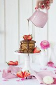 Spelt pancakes with strawberries and chocolate sauce