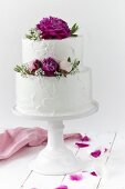 A wedding cake with spring roses