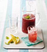 An ice-cold raspberry drink with vodka and ginger beer