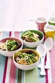Ramen noodles with green vegetables and steak