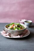 Broccoli salad with smoked mackerel, leaf spinach, tomato and rice