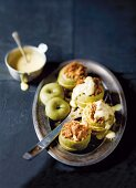 Baked apple with biscuit crumbs and vanilla sauce
