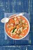 Tomato soup with meatballs, pasta and vegetables
