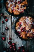 Bread pudding made of croissants with cranberries and sugar