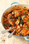 Chicken cacciatore: chicken breast braised in tomato sauce with mushrooms and olives