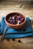 Red cabbage & blackberry coleslaw on a wooden table