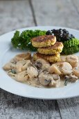 Black salsify and mushrooms in white wine sauce with millet seed burgers
