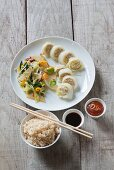 Chinese cabbage rolls with wok vegetables and rice