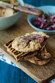Toasted bread with fish paste and pickled red onions