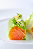 A Norwegian salmon roll with herbs and onions