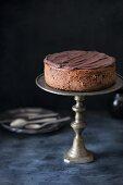 A chocolate cheesecake with chocolate ganache