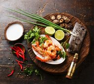 Ingredients for spicy Thai soup Tom Yam with Coconut milk, Chili pepper and Seafood