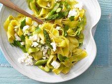 Flat ribbon pasta with green asparagus and sheep's cheese