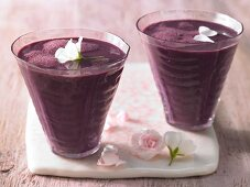 An elderberry mixed drink with soya milk and mineral water