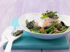 Halibut on a bed of beansprouts with beans and roasted nori seaweed