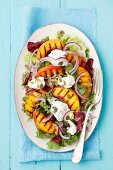 A salad with grilled peaches and goats' cheese