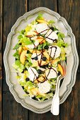 Chicory and cos lettuce salad with nectarines, blueberries and goats' cheese