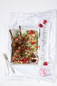 BBQ chicken skewers in a strawberry and whiskey marinade with strawberry tabouleh