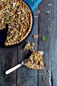 Pecan tart with honey, sliced