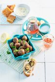 Meatballs stuffed with almonds and olives