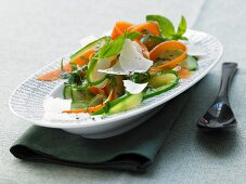 Stewed cucumber with carrots and Parmesan cheese