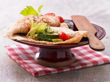 Spelt pancakes with tomato and courgette