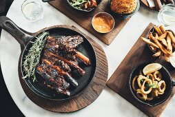 Marinated beef ribs and calamari rings at the Potato Shed restaurant (Johannesburg, South Africa)