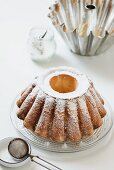A freshly baked Bundt cake dusted with icing sugar