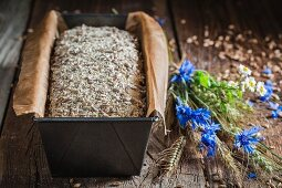 Healthy unbaked wholemeal bread in a loaf tin